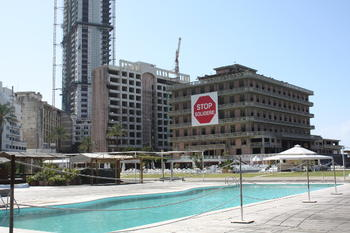 "A sign at the famous St. George Hotel protesting against the reconstruction project of post-war Beirut and the company running it, both known as ""Solidere"" (Beirut)"