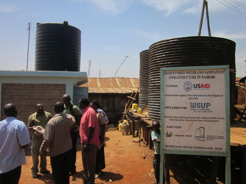 WSUP staff at project site - Visiting water storage tanks in Kibera/Kenya